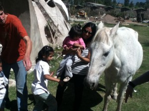 Nohemi and Teresa petting a horse for the first time... He might be big, but he's a sweetheart!