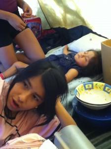 Catalina enjoying her afternoon siesta, and Johana finishing her meatballs.