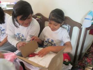 Bryssa opens presents from her dedicates padrinos.