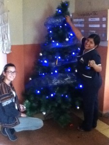 Tía Magdalena and Tía Bicelia decorate the tree in Pedacito de Cielo