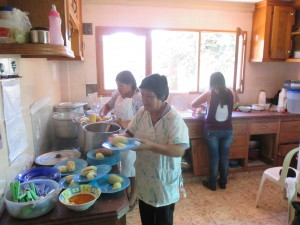Serving Picana (the traditional Christmas dish--a soup of chicken, beef, pork, potato, and corn)