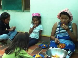 "Alayna, Valeria, and Elena, enjoying their ""refrigerio"" (snack)"