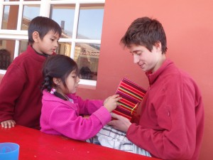Diego and Zamora giving Sam a goodbye book of drawings by all of the kids.